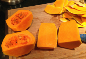 Cut the squash lengthwise, then into cubes