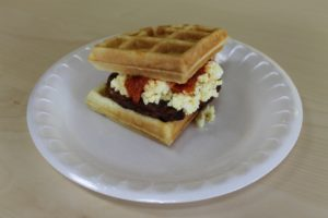 waffle, top one waffle piece with some scrambled eggs and turkey sausage. Dress it up with some hot sauce if you desire.